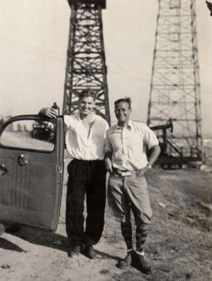 Anthony Ausgang's grandfather, Henke Wenckebach (right) along with an unidentified man, an oil well and a whiskey bottle. Photo courtesy Anthony Ausgang