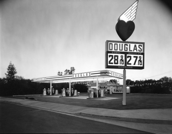 Early evening view of Douglas gas station and its sign advertising their gas prices | Courtesy of the Los Angeles Public Library
