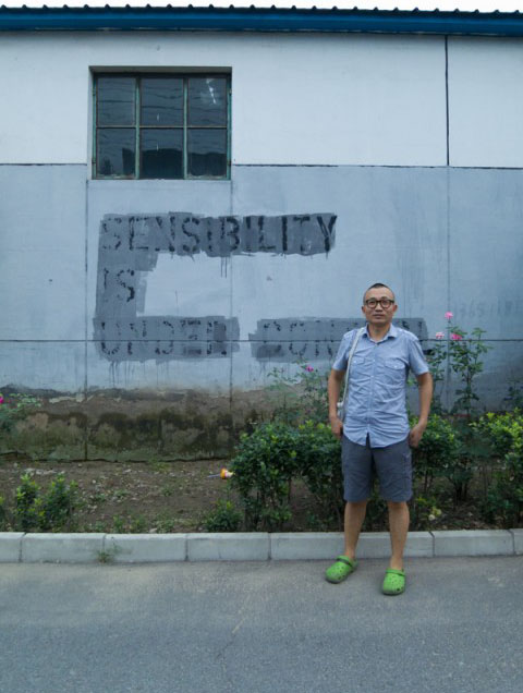 Ma Yongfeng with 'Sensibility is Under Control' painted over | Photo by Daniel Lara