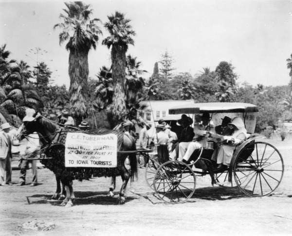 Hollywood Old Settlers Parade in 1927 included this entry, with banner on horse that reads 'C.E. Toberman trying to sell Hollywood Boulevard at $30.00 per Front Ft. in 1907 to Iowa Tourists' | Courtesy of the Los Angeles Public Library