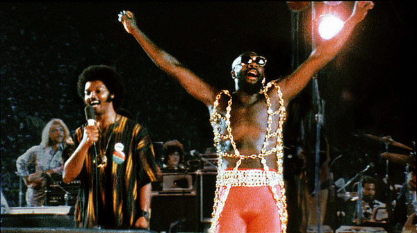 Isaac Hayes performing at Wattstax, with Rev. Jesse Jackson, at the Los Angeles Memorial Coliseum | Credit: Courtesy of Wattstax
