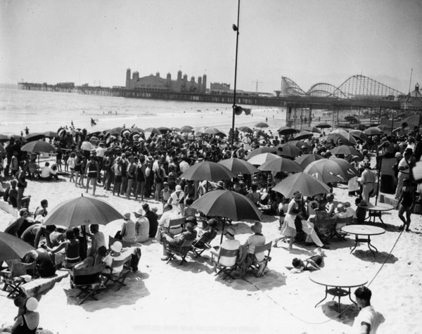 1930 beach party, with Santa Monica Pier in the background | Courtesy of the Los Angeles Public Library