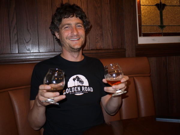Tony Yanow holding up a glass of Aunt Sally's Pale Ale and It's Always Not Sunny in L.A.