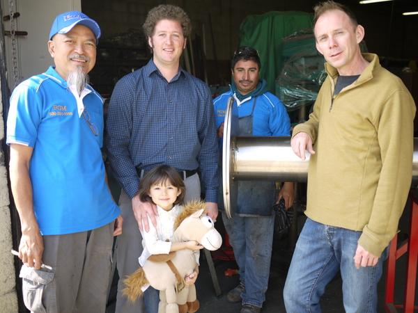 Street pole fabricators Noy Lee and Jeremy Ochoa with Thai CDC staff Curtis McElhinney, Tyler Forester, and daughter Zoë Forester--George Villanueva