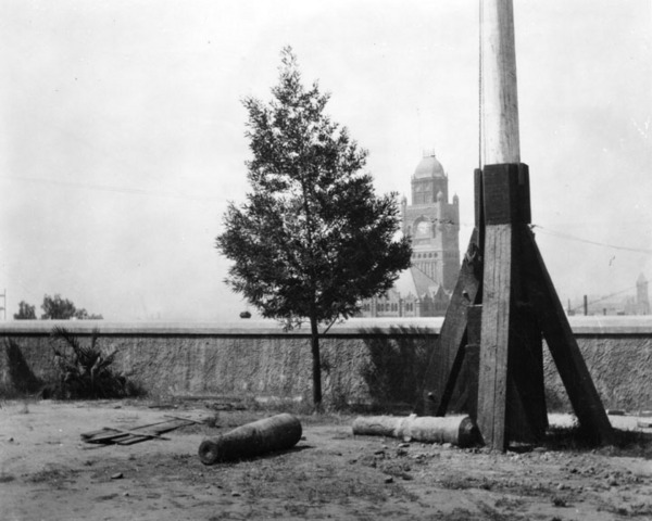 Flagpole and cannon remnants at Fort Moore in Los Angeles. The old Los Angeles County Courthouse is visible in the background. | Courtesy of the Los Angeles Public Library