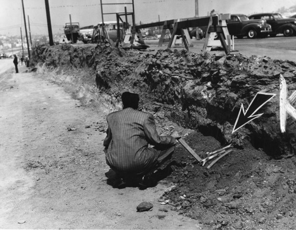 Arrow points to bones of pioneer California soldier unearthed as Hollywood Freeway excavation cuts into the old Fort Moore Hill Cemetery, April 2, 1951 | Herald-Examiner Collection, courtesy of the Los Angeles Public Library