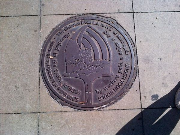 Manhole cover as public art, by Kim Abeles