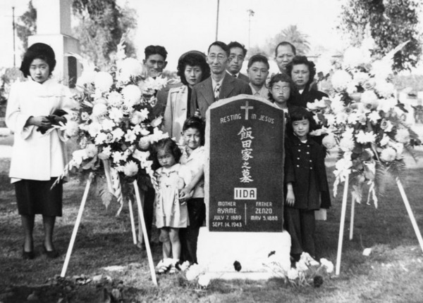 Japanese American family at Evergreen Cemetery in Boyle Heights, at gravestone of Ayame and Zenzo Iida, 1949 | Shades of L.A. Collection, courtesy of the Los Angeles Public Library