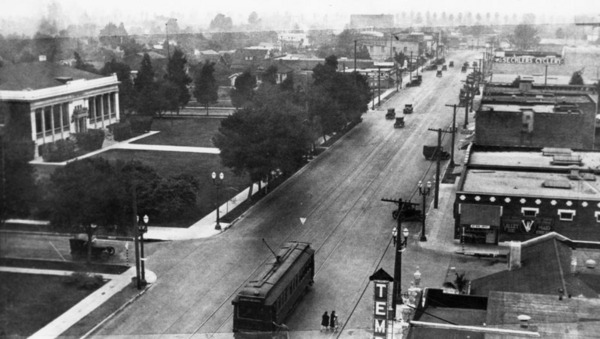 Main Street in Alhambra, ca. 1920, with Public Library visible on the left | Security Pacific National Bank Collection, courtesy of the Los Angeles Public Library
