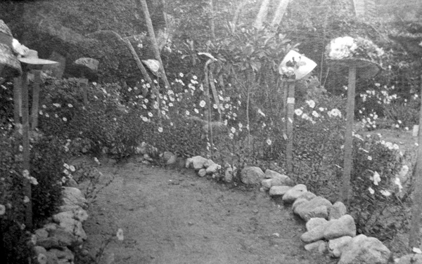 Olive's hats on posts for garden party. | Photo courtesy Ella Strong Denison Library, Scripps College
