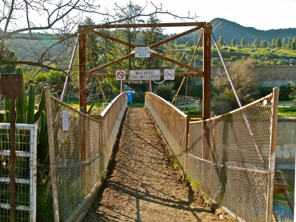 Cross horse bridge at your risk, reads the sign. This path leads into Griffith Park.