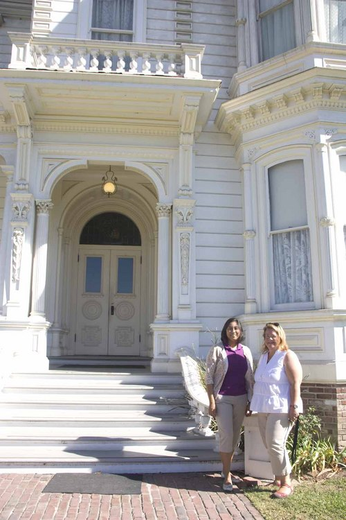 Jessica Rivas and Dana Anderson by the Perry Mansion, the largest home in the museum's collection.