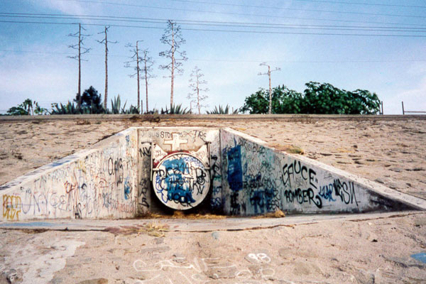 Many of Leo Limon's River Catz have been scrawled over by tags or buffed out completely by graffiti abatement crews. 1999 I Photo by Juan Devis