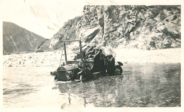 Henry O'Melveny was an advocate for better roads along the San Gabriel Canyon. Although the river got the better of the automobile in this circa 1915 photo, graded roads were part of the canyon landscape before 1930 | Courtesy of John G. Tomlinson, Jr.