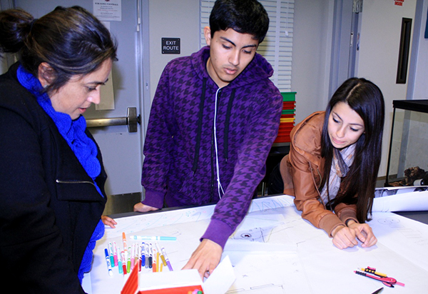 Students share their draft concept design with MRCA Urban Planner, Barbara Romero.