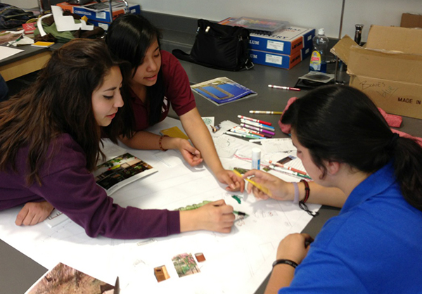 Students work together to develop the designs for their group's Rio Vista Project.