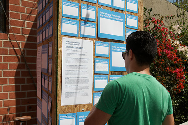 Attendees wrote down their thoughts on the vision plan at the kiosk.