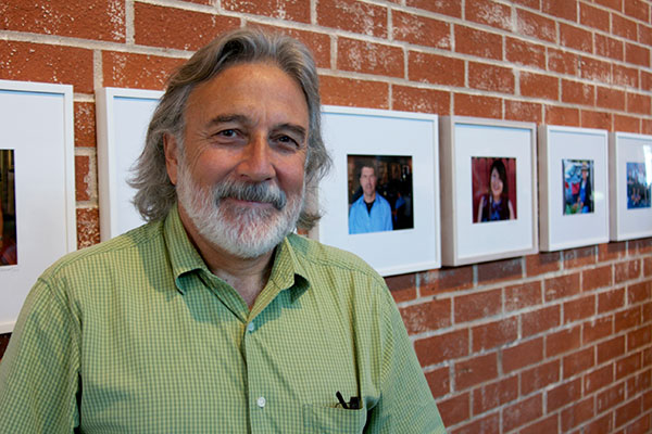 Ricardo Palavecino with his portraits