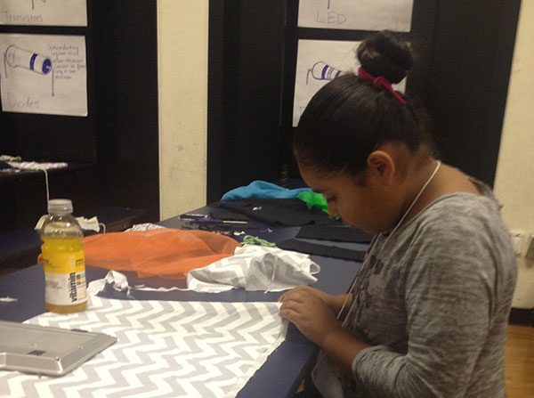 Vanessa Acuña sews her purse on Day 1 of Fashion and Wearable Technology Week at DIY Girls Summer Camp