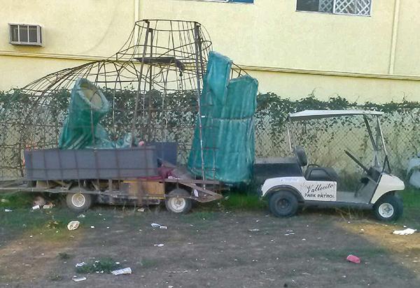 Strange, large trash items surround the lot