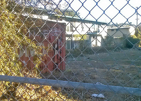 A veiw of the vacant lot through the front fence