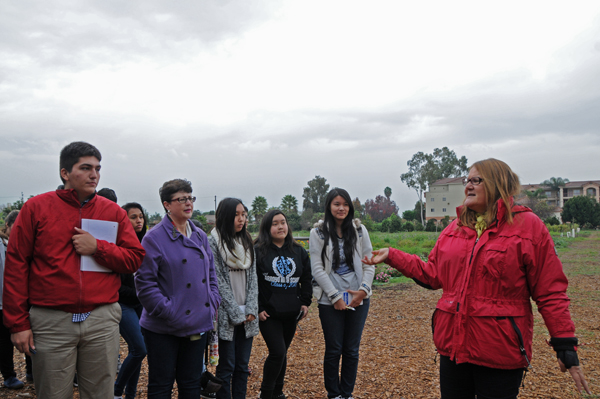 Marianne welcomes the students to Earthworks Farm