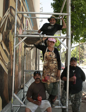 The muralist, beginning at the top, Joe Bravo, Sonya Fe, Raul Gonzalez & community volunteer Joseph