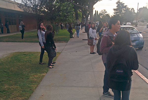 Students wait to get picked up in front of Mountain View High School