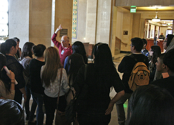 The students met their tour guide Mark, who pointed out the murals on the ceiling and other artistic elements