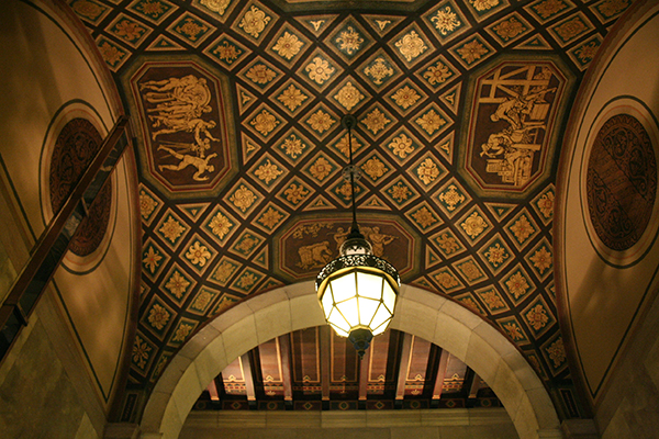 The other ceiling panels are decorated with subjects representing Motion Pictures, Industry, commerce, agriculture and art.
