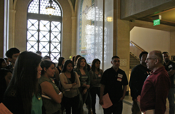 As the students were guided towards the Mayor's office, they passed the reception desk framed by a colorful tiled wall and one of the many elaborate windows