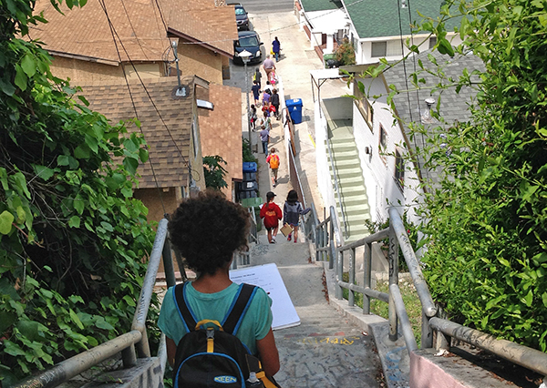 Students walk down stairs towards the Arroyo Seco and Heritage Square