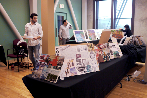 Teaching artists and coordinators set up the students' work at La Plaza de Cultura y Artes