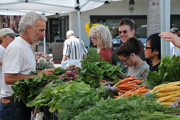 Phil McGrath (aka Farmer Phil) at a farmers market | Courtesy McGrath Family Farm