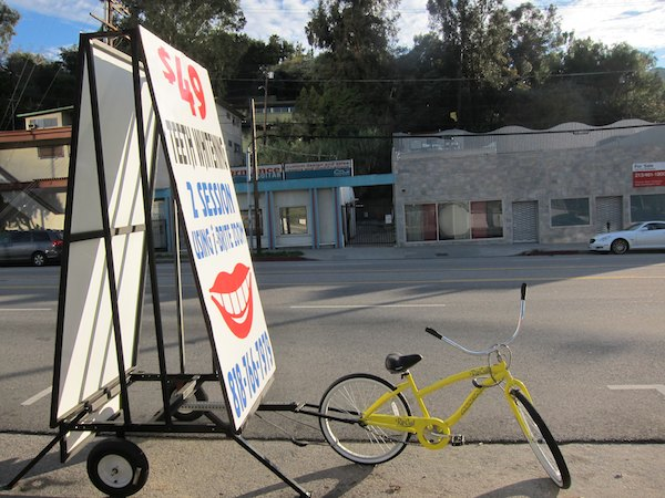 A bicycle attached to a mobile billboard on Cahuenga Boulevard on the Cahuenga Pass | Photo by Zach Behrens/KCET