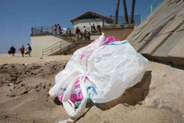The wind blows a plastic bag around the beach near the Manhattan Beach Pier | Photo by David McNew/Getty Images