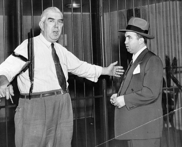 A U.S. Marshal introduced Cohen to the jail where he was held immediately after his 1951 conviction on tax-evasion charges. Courtesy of the Herald-Examiner Collection, Los Angeles Public Library.
