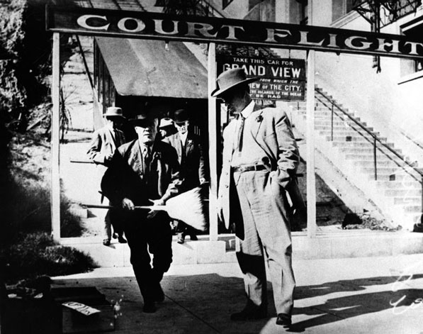 Men at the lower entrance to Court Flight. Courtesy of the Los Angeles Public Library Photograph Collection.