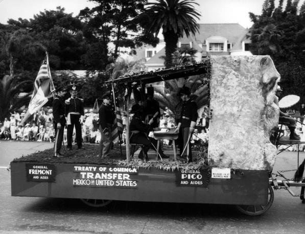 A re-enactment of the signing of the Capitulation of Cahuenga on a parade float. Courtesy of the Los Angeles Public Library Photograph Collection.