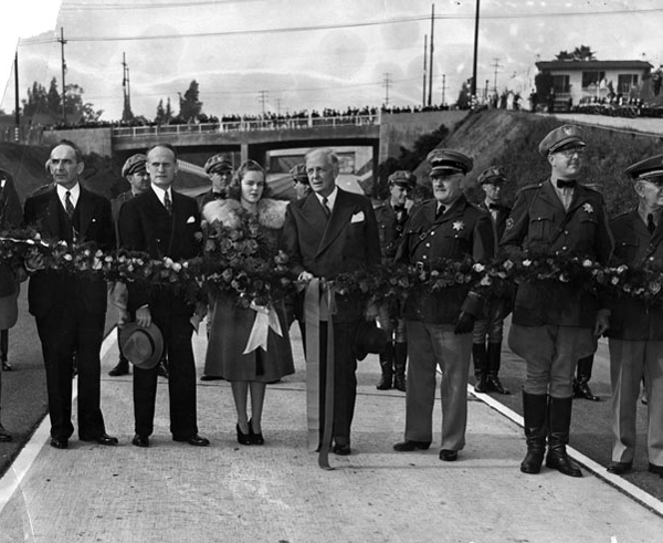 Opening ceremony for the Arroyo Seco Parkway on December 30, 1940. Rose Queen Sally Stanton was joined by Governor Culbert Olson. Courtesy of the Herald-Examiner Collection, Los Angeles Public Library.