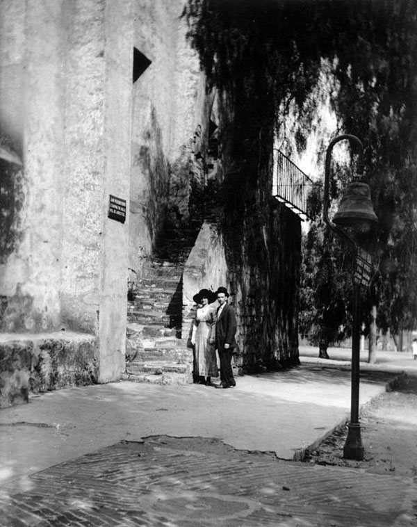 An El Camino Real bell outside Mission San Gabriel in 1912. Courtesy of the Photo Collection, Los Angeles Public Library.