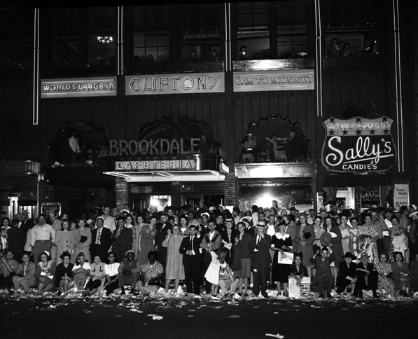 A crowd celebrates V-J Day in front of Clifton's on August 14, 1945. Courtesy of the Los Angeles Public Library Photograph Collection.