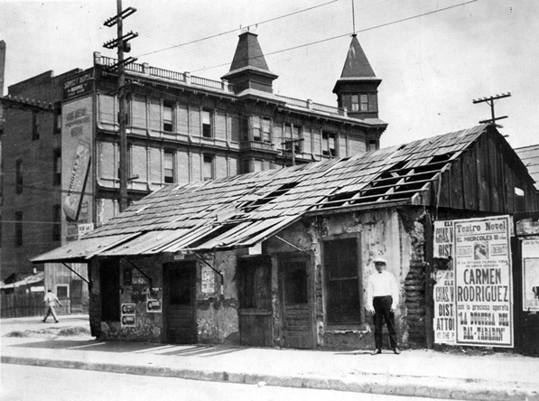 An aging adobe house sits across the street from the Sunset Hotel at the present-day intersection of Spring and Ord in Sonoratown. Courtesy of the Los Angeles Public Library Photograph Collection.