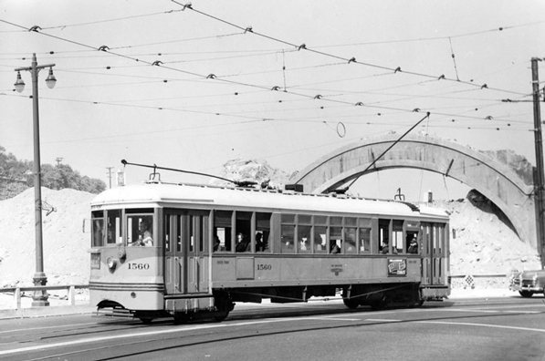 A Los Angeles Railway streetcar bypasses the demolished Broadway tunnel, its entrance arch still standing, in 1949. Courtesy of the Los Angeles Public Library Photograph Collection.