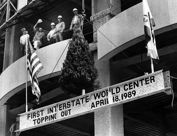 The final steel beam made its way to the top of the 1,018-foot Library Tower, by then renamed the First Interstate World Center. Courtesy of the Herald-Examiner Collection, Los Angeles Public Library.