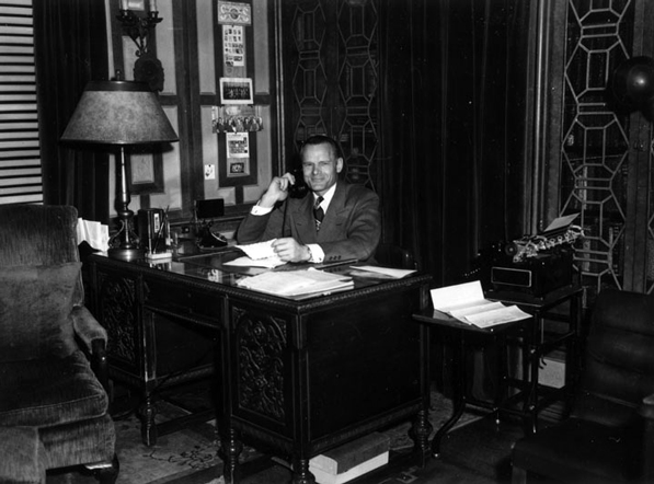 A smiling Clifton's founder Clifford Clinton in his office in 1947. Courtesy of the Los Angeles Public Library Photograph Collection.