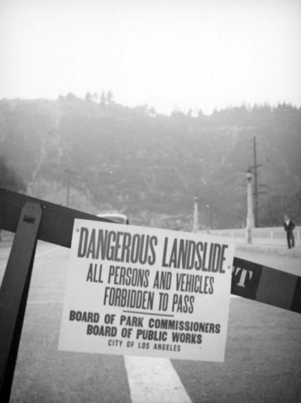 Police barricades kept curious onlookers safely away from the landslide. Courtesy of the Herman J. Schultheis Collection - Los Angeles Public Library.