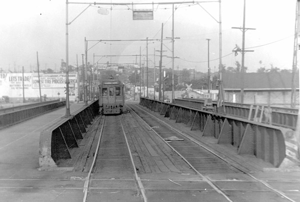 A streetcar crosses the Aliso Street bridge over the Los Angeles River. Courtesy of the Metro Transportation Library and Archive.