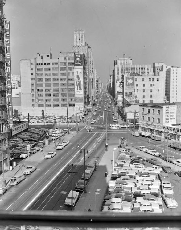 A later view of the intersection of Broadway and Olympic, showing the surface parking lot that would eventually claim Broadway Place. Courtesy of the Metro Transportation Library and Archive. Used under a Creative Commons license.