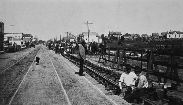 Workers installing cable car tracks in Boyle Heights. The tracks to the left were used by horse-drawn streetcars, which cable cars replaced. Courtesy of the Metro Transportation Library and Archive.